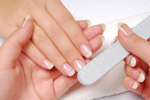 Studio nail — beautician polishing female nails