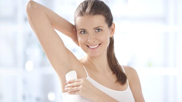 woman_using_deodorant_000019041958