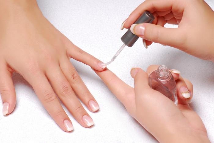 Skin care. Applying of the Transparent varnish.